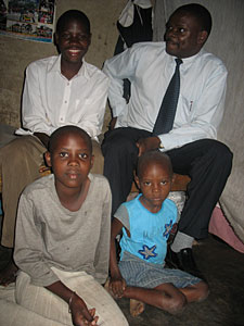 Dr. Yona Kapere with a Compassion-assisted family