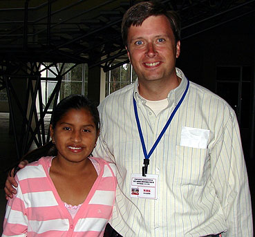 Mark with his sponsored child Karen