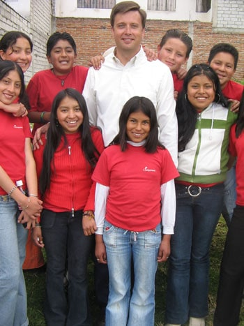 Mark with sponsored children in Ecuador