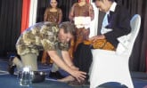 Wess Stafford washes the feet of a Leadership Development Program graduate.