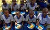 uganda-girls-eating-outside