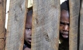 children behind fence_KE