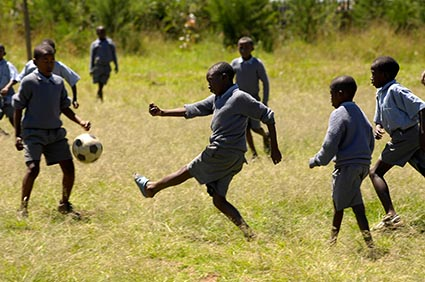 Sponsored children playing soccer in Kenya