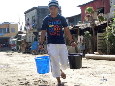 young man carrying two buckets