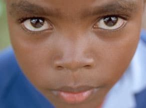 closeup of a serious looking child's face