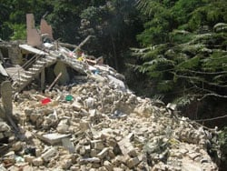 rubble of destroyed home