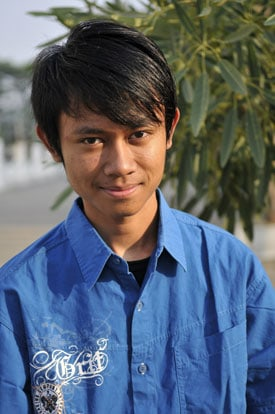 smiling young man in blue shirt