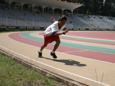 boy running on track