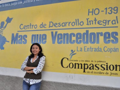 Vilma Canales in front of sign