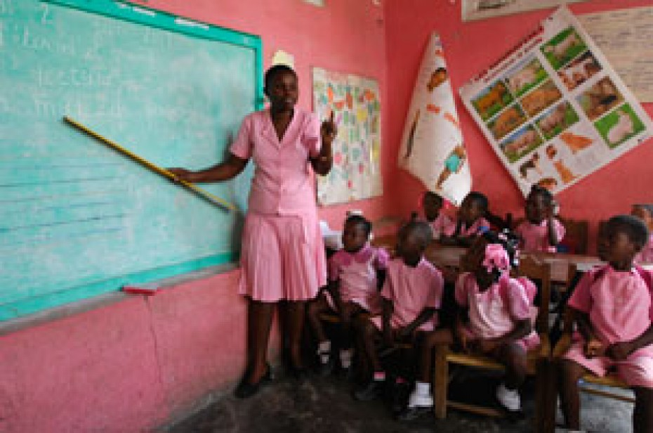 woman teaching young children in classroom