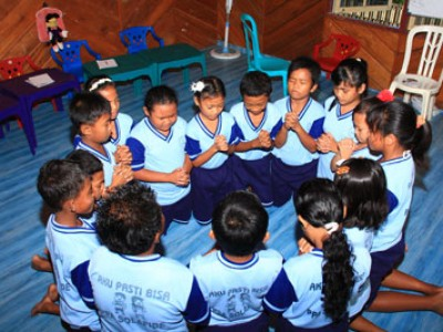 group of kneeling children praying