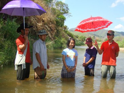 people standing in river to be baptized