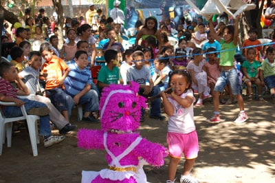 children celebrating with pinata