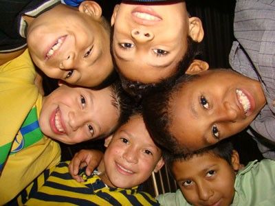 group of children looking down at camera