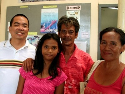 Filipino girl with parents and pastor