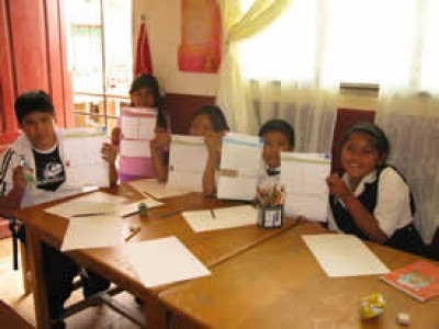 five children holding up letters