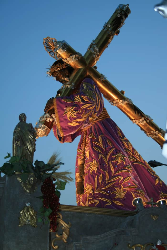 A statue of Jesus carrying the cross for a parade for Easter in Guatemala
