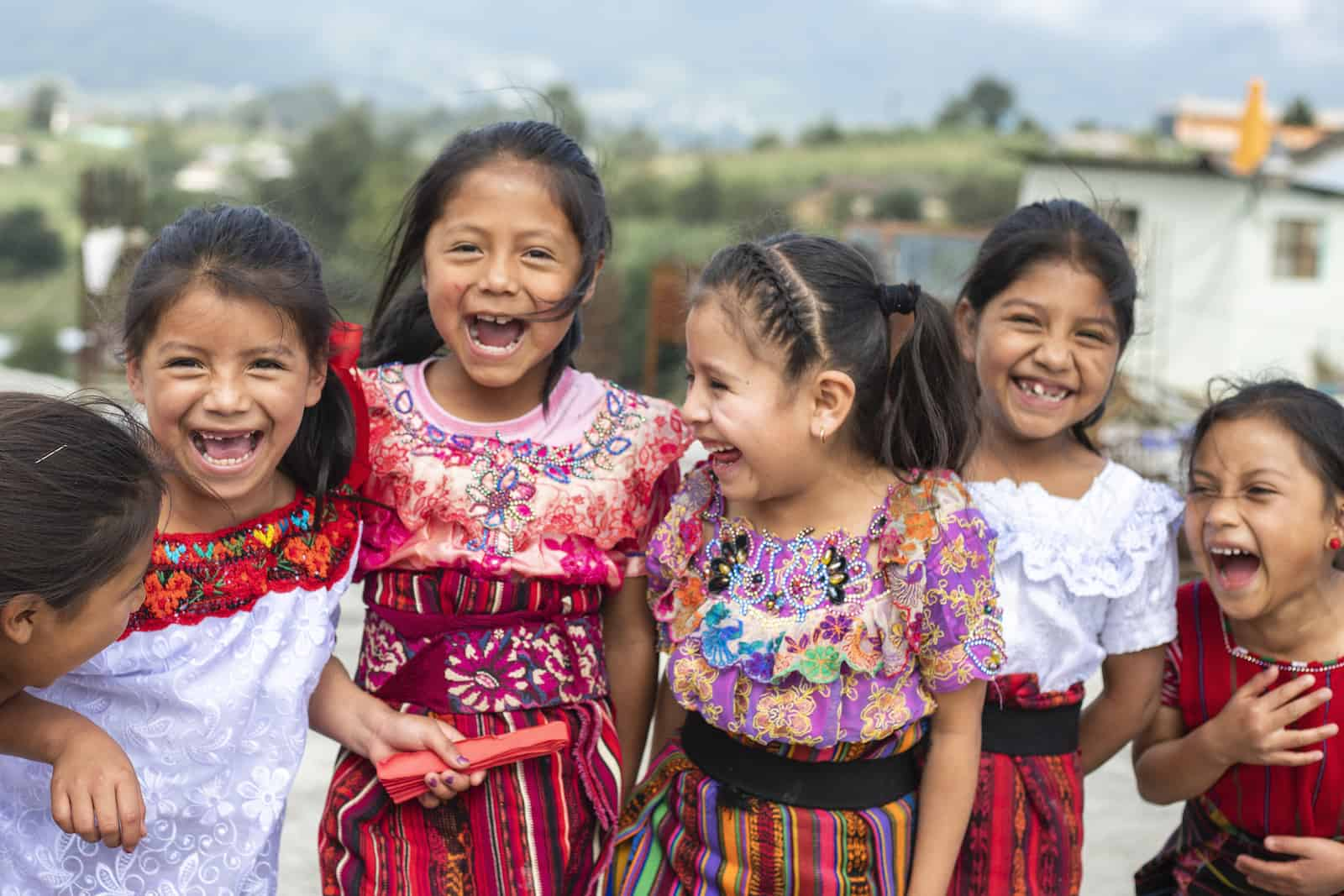 A group of girls in colorful, traditional dress in Guatemala.
