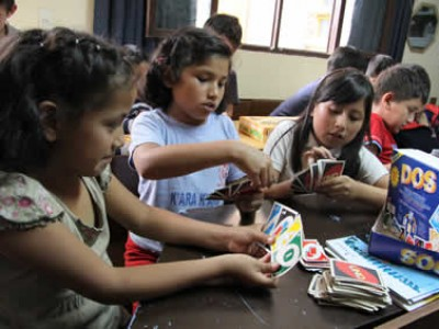 children playing card game