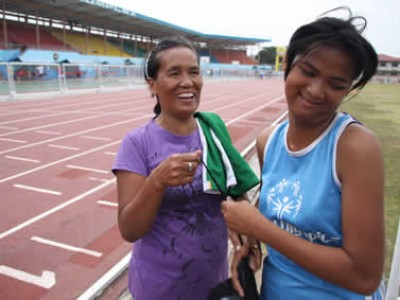 woman with girl in track uniform