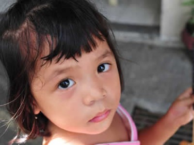 Young girl looking up into the camera.