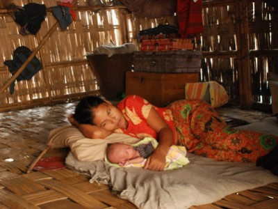 mother and baby on floor of home