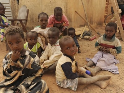 A group of children sitting on the ground