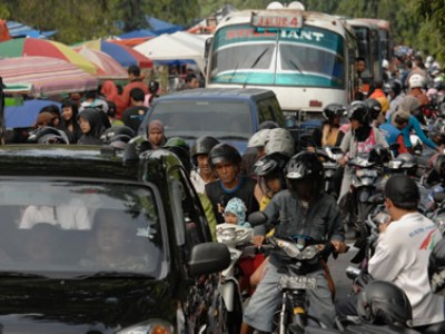 crowded street with vehicles and people