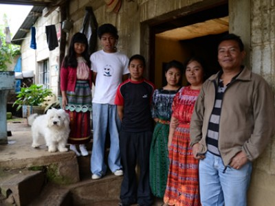 family outside home in Guatemala