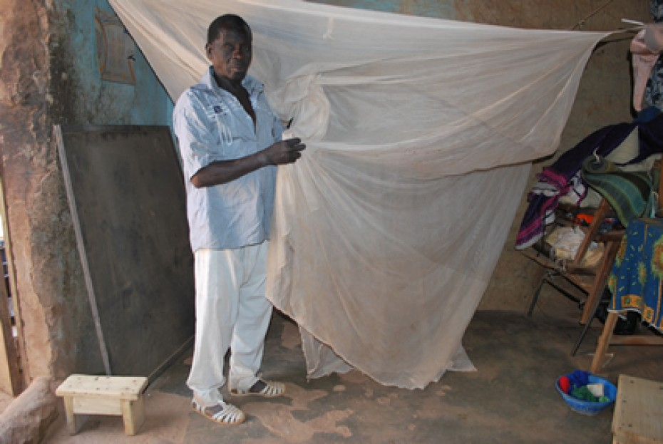 Man holding a mosquito net.
