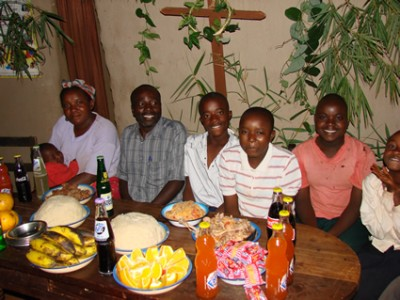 A family sitting at a table with food