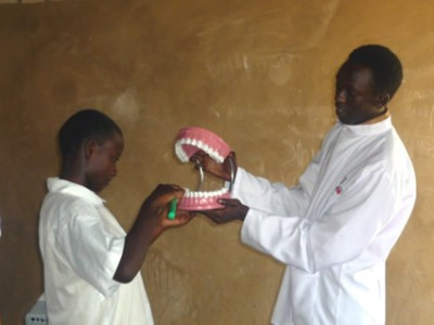 a man showing a set of teeth to a child