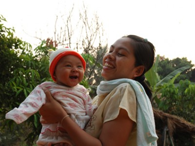 woman holding smiling baby