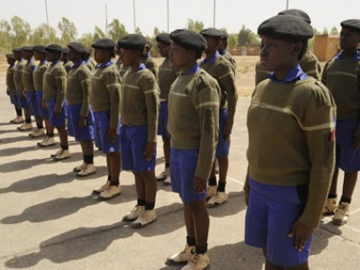 teens standing at attention in uniforms