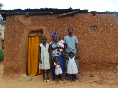 family standing outside home
