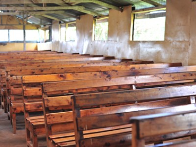 wooden benches inside Kenyan church