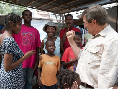 Wess Stafford with Haitian family