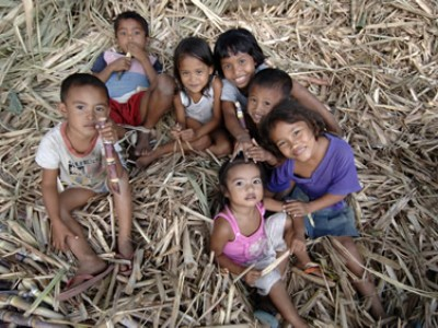 group of children sitting in hay