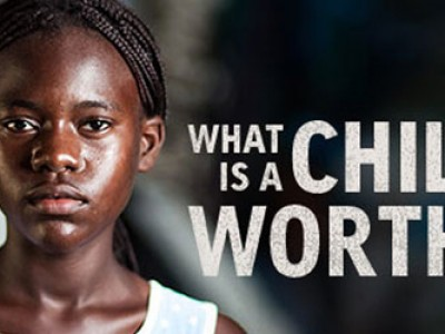 a graphic with a serious looking girl with text what is a child worth?