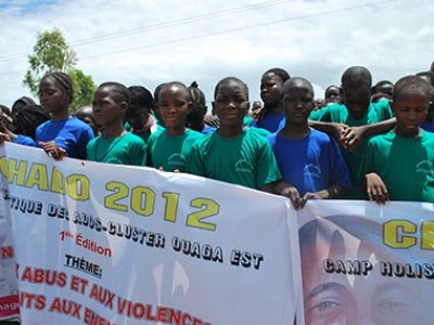 group of children holding banners