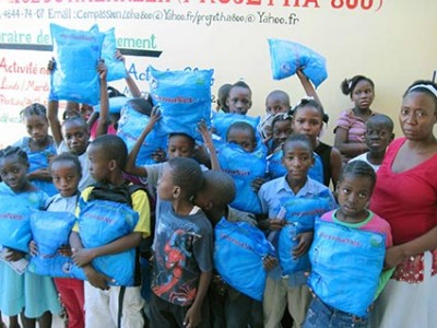group of children holding malaria nets