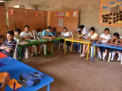teens at tables in classroom