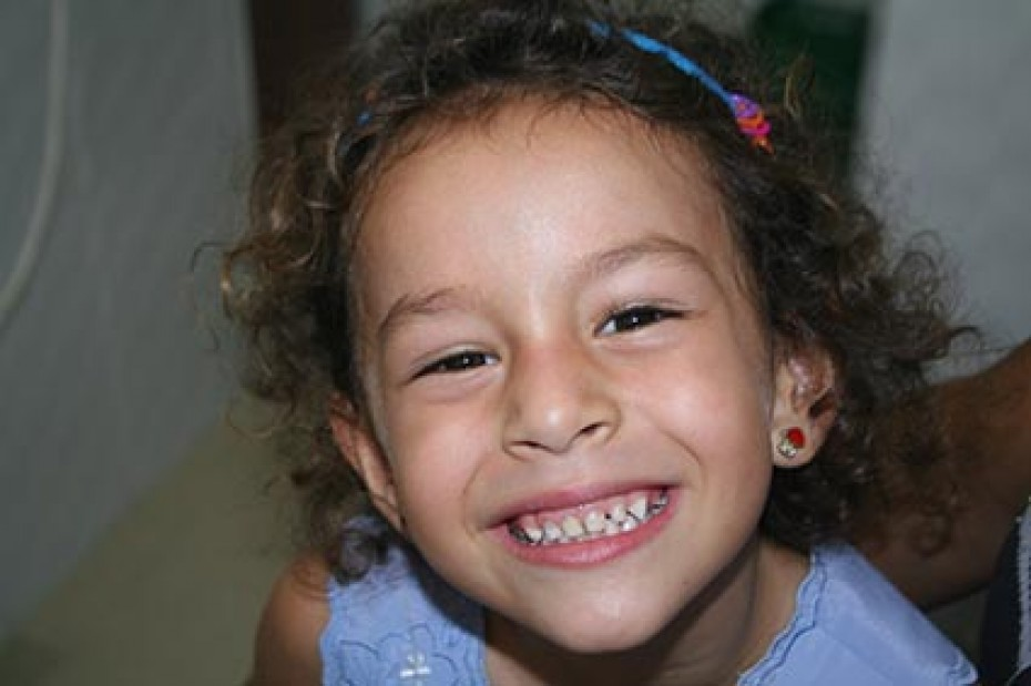 smiling girl showing her teeth