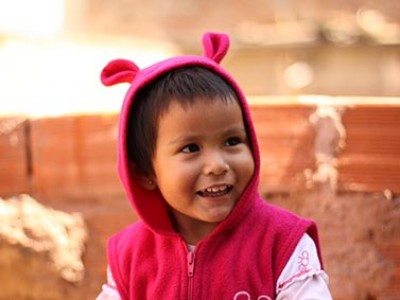 young child wearing pink hooded jacket