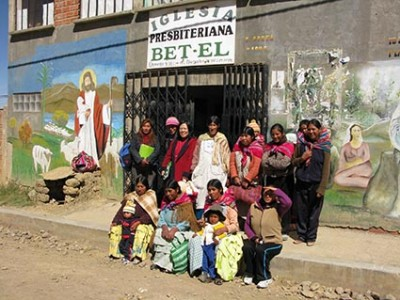 Women and children outside of church