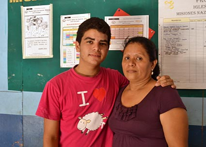 young man with arm around older woman