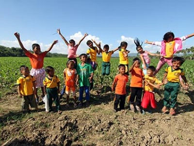 group of children jumping in air