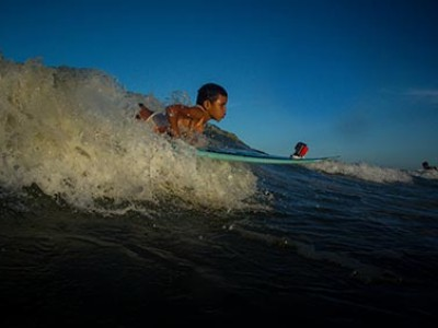 young boy on a surfboard
