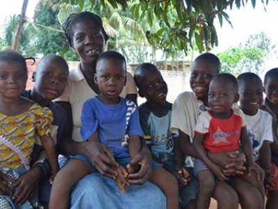 group of happy children with a caregiver