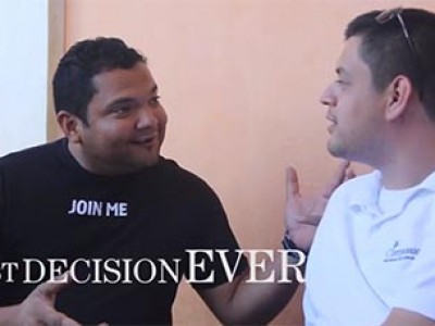 Two men talking - One in a black shirt and one in a white shirt